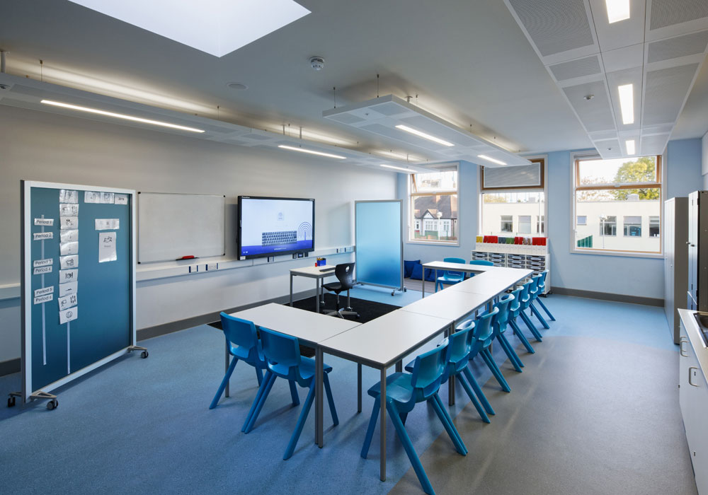 The building's classrooms, hall and dining areas are naturally ventilated using passive stack ventilation. Roof-mounted wind driven ventilation terminals in the hall and dining room are designed to 'capture' prevailing wind and direct it via four separate chambers within the terminal to the space beneath. The building achieved a BREEAM 'Excellent' rating.