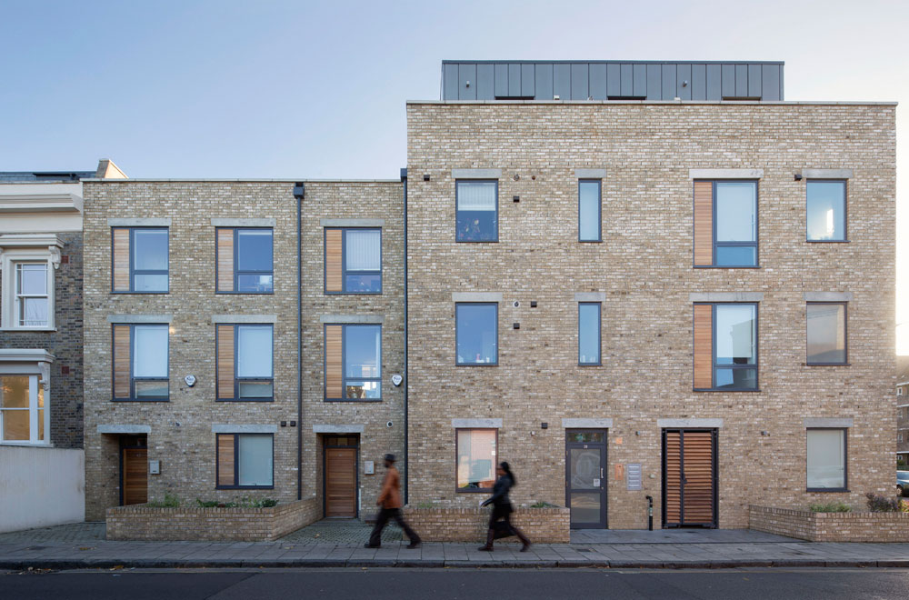 The new-build residential development is built on an empty corner site on Marmont Road, adjacent to two Victorian terraces. The project comprises of eight residential units, including one duplex unit. The height and facade provide a suitably robust form to this prominent corner site, whilst remaining harmonious to the scale of the neighbouring buildings. A simple palette of brick, timber, zinc cladding and stone provide a sympathetic contemporary response to the surrounding context.