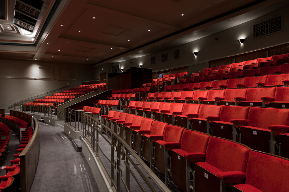 The refurbishment project restored the historic elements of the Grade II listed building while upgrading the infrastructure of the auditorium with modern audio-visual facilities and a large stage auditorium suitable for traditional theatre activities, teaching and examination space.