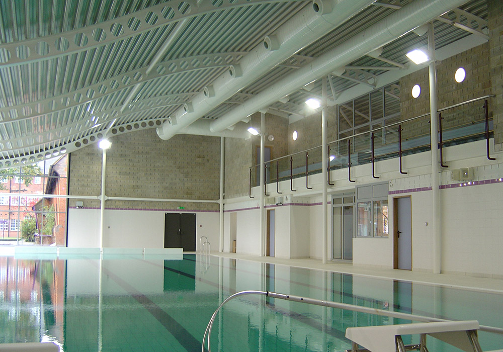 We provided all mechanical and electrical services for the new build school swimming pool on a sensitive site within existing school grounds. The project formed the first part of the school development plan, which included a new auditorium and sports hall. The terracotta clad building with contemporary curved roof houses a four lane 25m pool with fully accessible changing facilities with separate male and female changing and a viewing balcony.