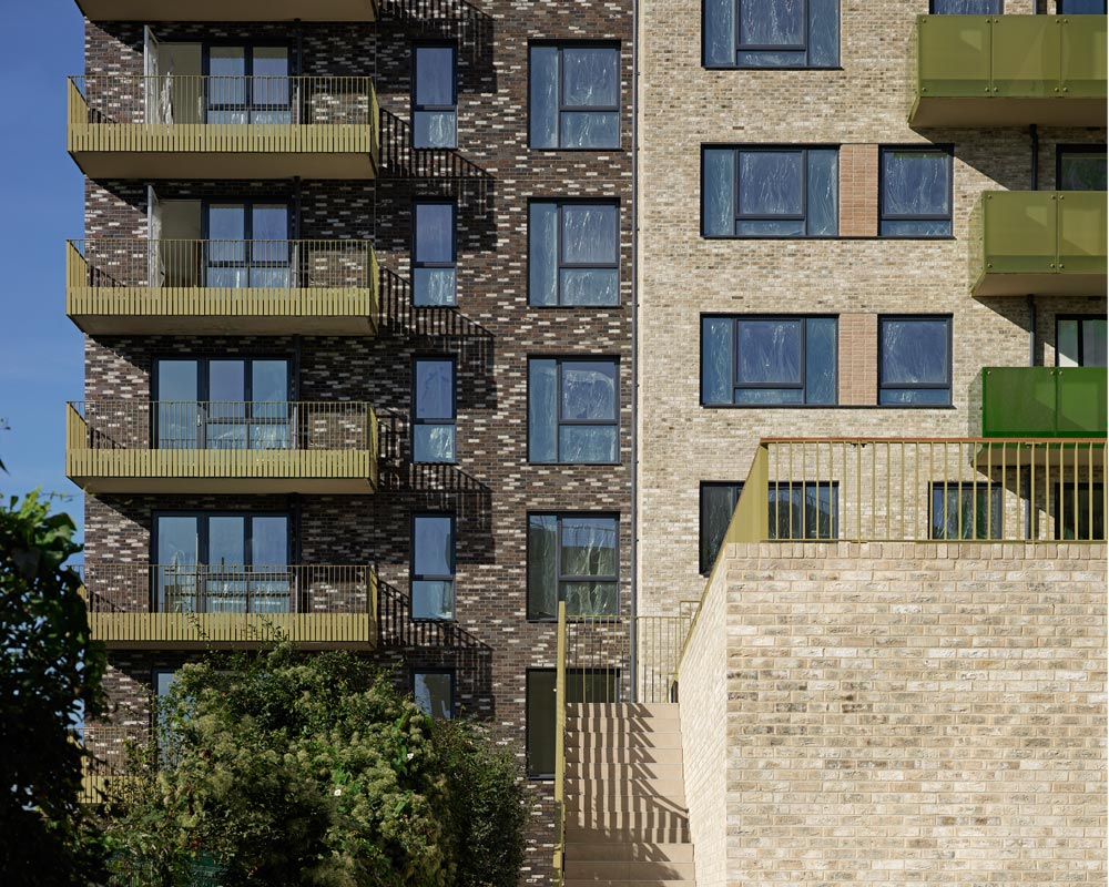 A specific mechanical and electrical design was formulated in liaison with the client to enable rollout and incorporation to all phases regardless of layouts or architectural intent. The services specification and strategies have remained consistent for all phases and were designed to accommodate the future provision of district heating for the masterplan. Each project was designed to meet the minimum Code for Sustainable Homes Level 4, and a BREEAM standard of 'Excellent'. The site incorporates a gas-powered CHP Energy Centre. All dwellings match or exceed the standards of The London Plan and London Housing Design Guide.